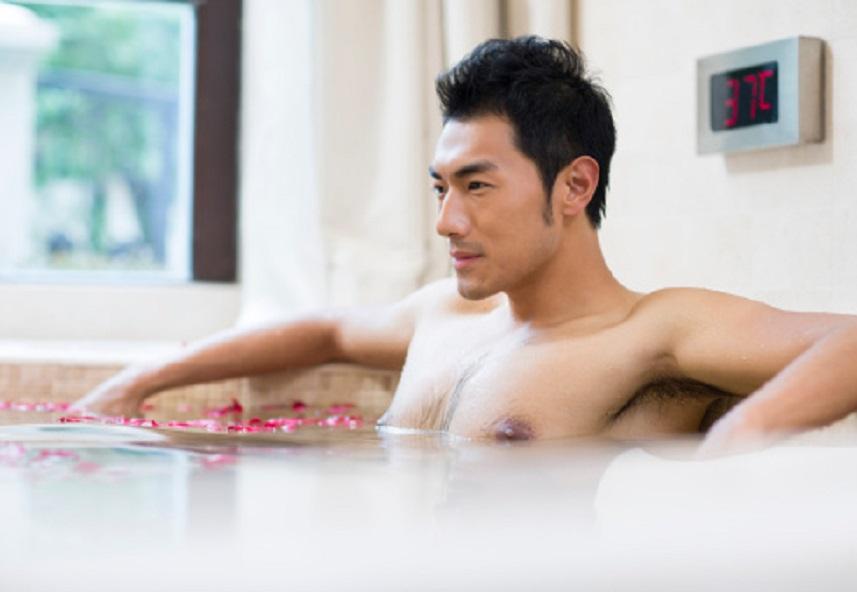 Young man relaxing in a nice hot bath